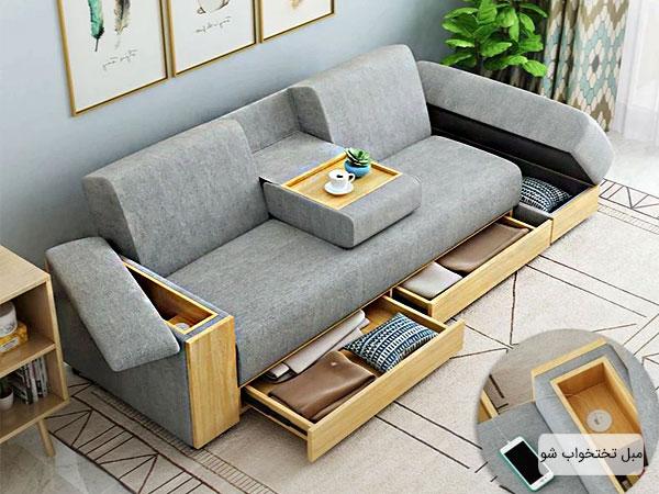 تصویری از یک کاناپه تختخواب شو با همه امکانات در فضای داخلی منزل