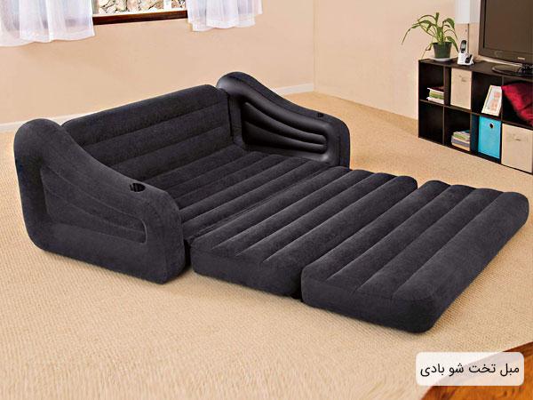 تصویری از یک مبل تخت خواب شو بادی با رنگ سرمه ای در فضای خانه