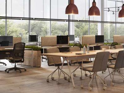 فضاي يک اداره امروزي که داراي چندين ميز و صندلي به رنگ کرمي مي باشد و روي هر ميز يک مانيتور قرار دارد