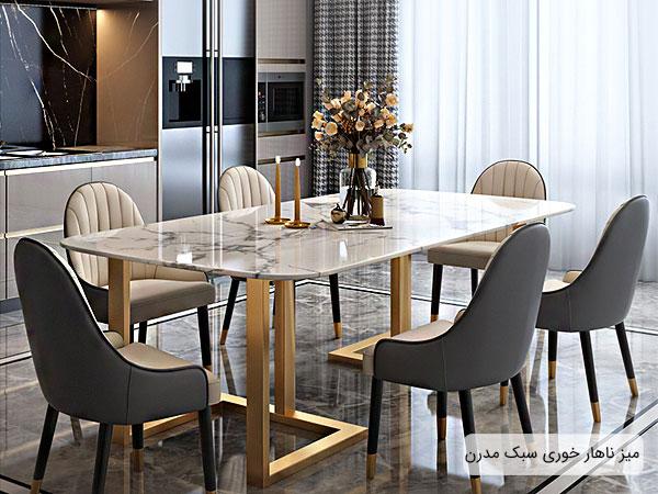 تصویری از یک میز ناهار خوری بزرگ در میان دکوراسیون داخلی فضای خانه