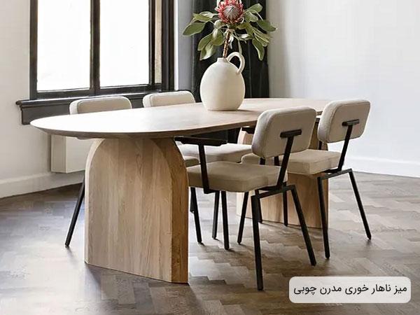 تصویری از یک میز ناهار خوری چوبی طراحی شده برای دکوراسیون داخلی