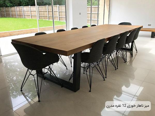 تصویری از یک میز ناهارخوری 12 نفره مدرن در فضای خانه مشخص می باشد.