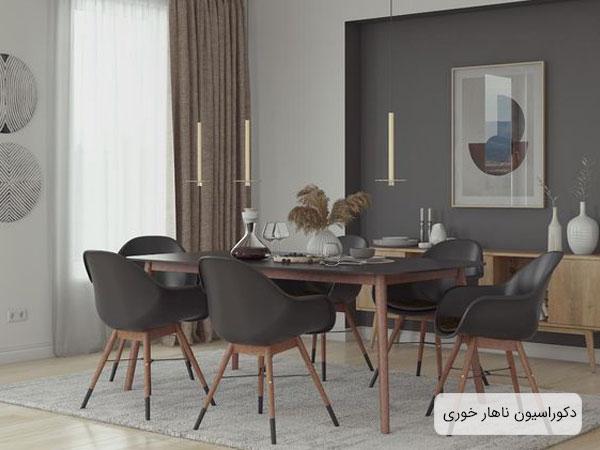 دکوراسيون آشپزخانه که شامل يک ميز ناهار خوري، چند عدد صندلي ناهار خوري، به رنگ مشکي و پايه هاي قهوه و يک فرش، کابينت، نقاشي ها و ساير لوازم دکوري مي باشد