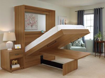 تصوير يک تخت خواب ديواری مدرن به رنگ قهوه ای روشن و يک عدد ميز کنار تختی به همان رنگ .