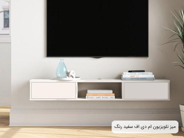 تصويري از ميز تلويزيون Z32 ديواری به رنگ سفيد و جنس ام دي اف که بر روي ديوار نصب گشته است