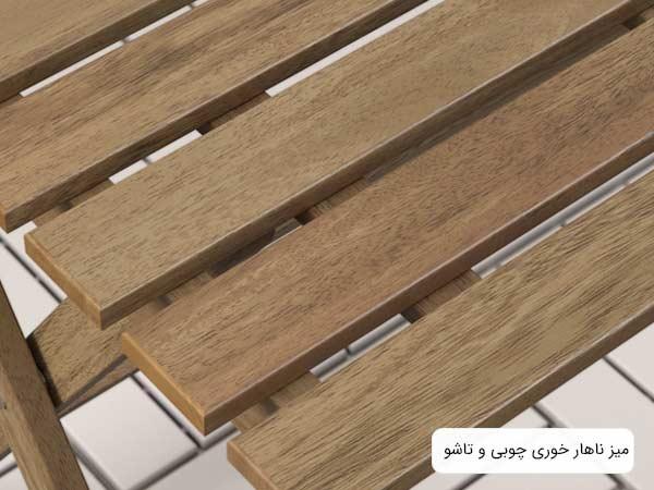تصويری از نمای نزديک يک ميز ناهارخوری چوبی با طراحی ساده و شيک